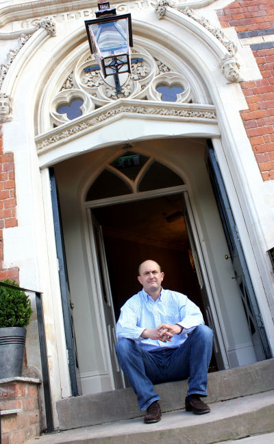 Ian Dowling on the steps outside the historic Talbot Inn.