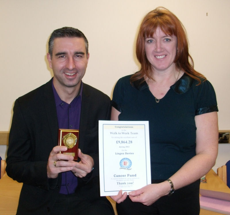 Pictured with the award are Nick Holding, an Improvement Manager, and Sally Hodson, a Project Support Co-ordinator.