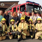 "Manager Neil Groves (Centre) with Hodnet firefighter Ruth Walkerdine (left) and Watch Commander Debbie Davies with 12 women who attended the firefighter ""taster""session at Craven Arms fire station over the weekend."