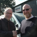 John Smallman, co-owner of National Windscreens branches in Telford, Oswestry and Wolverhampton welcomes new business development manager Mark Evans.