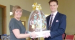 Jamie Doran from Wyatt Bros presenting Carol Twomey of Severn Hospice with the giant Easter egg - one of only 200 made in the country.
