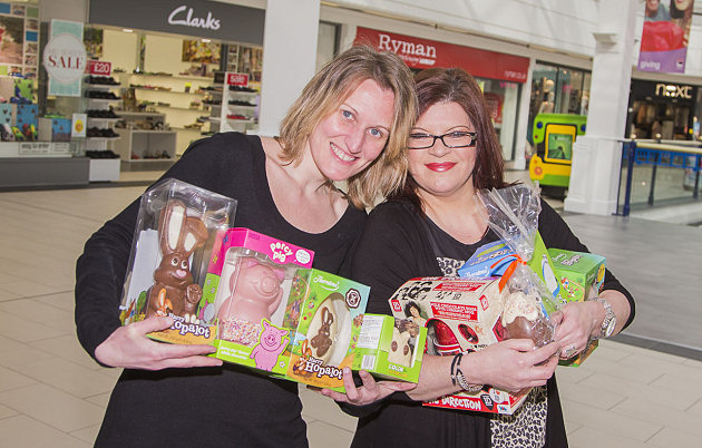 Miriam Salas and Sharon Griffiths from the Management Suite at Pride Hill with some of the prizes for the Easter Egg Hunt.