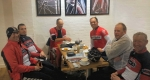Cyclists enjoy coffee at Stan's Cycles cafe