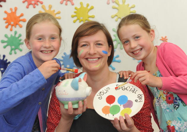 Splat and Splodge owner Kelly Wood with young customers, from left, Lucy, 8, and Molly, 6,  Harper of Shrewsbury.