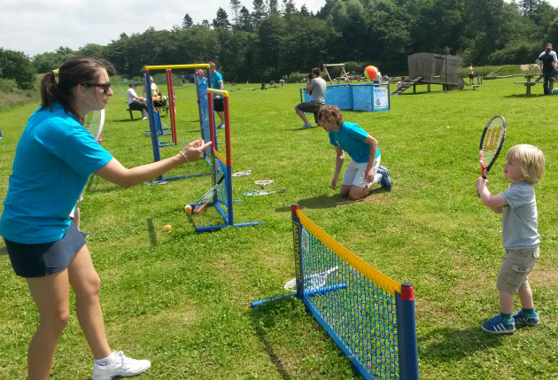 Charlie Dunn, 3, receives some advice from coach Stephanie Davies during the Tennis in the Park event at Attingham Park.