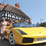 Helen Griffiths and Paul Edwards with the Lamborghini Spyder at The Quarry gates, Shrewsbury.
