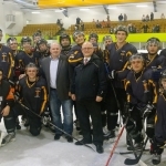 Tigers NIHL line up for the camera with Red Hockey owner Wayne Scholes (left) and NIHL General Manager Mike Washburn