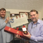 Mark Cashmore and Peter Duckers pictured with the Grant of Arms document and case.