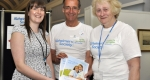 Alzheimer's Society Community Fundraiser Emily Woodward with volunteers Roy Broad and Valerie Brown.