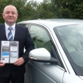 John Cutler, owner of Wenlock Executive Hire, with the newly launched in-car business directory.