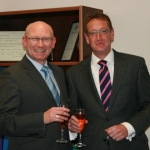 Pictured raising a glass to celebrate the double achievements this month are directors Rob Andrews and Jonathan Ritson