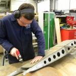 Apprentice Matthew Treanor Cartwright works on a restoration