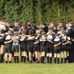 Bridgnorth 1st XV take part in a post match huddle with the Under 10s