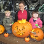 Pictured carving pumpkins at the Halloween Barn at Hoo Farm are Stanley Hindle, Lucy Holbrook and Phoebe Blackwell from ABC @ Hoo