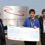 Shrewsbury College of Arts & Technology principal Steve Wain looks on as Charles Howell of Cooper Green Pooks presents L3 Creative Media student Jamie Burgoyne with a cheque for £100