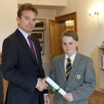 Mark Groome, headmaster of Prestfelde, presenting Patrick with his award