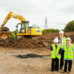 Telford College Assistant Principal Edward Bird marks the start of building work with current Bridge School students Katie Hinton, left, and Sarah Chesters