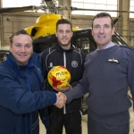 Manager Micky Mellon hands over the match ball to Station Commander Group Captain Alastair Smith, Statin Commander RAF Shawbury with player Jason Leutwiler watching