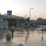 Water from the burst main flooded an area outside shops on Hereford Road. Photo: Steven Oliver