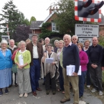 MP Philip Dunne with local residents of Ashford Bowdler at the Level Crossing