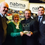 Pictured receiving the award from Sean Wilson, former Coronation Street Actor are the Mayor - Councillor J.G. Jones, Mrs C. Hawksley - Chairman of the Markets & Car Parks Committee and David Clough – Retail and Events Manager