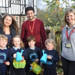 Pupils Sam Spiby, Willa Bowett, Thomas Pryce and Charlotte Owen with Head of Pre-Prep Suzanne Wakeley and visitors from the RHS