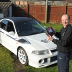 Paul Haynes with his own Mitsubishi Evo competition car