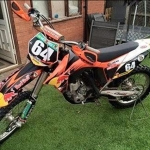 One of the motorcross bikes, orange in colour and made in 2012