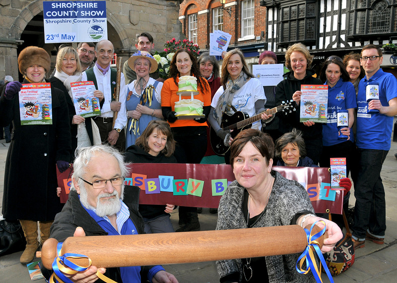 The Shrewsbury Festivals Baton is launched in the Square. Bill McCabe from the Shrewsbury Cartoon Festival, front left and Karen Higgins from The Big Busk with the Baton, joined by other festival representatives