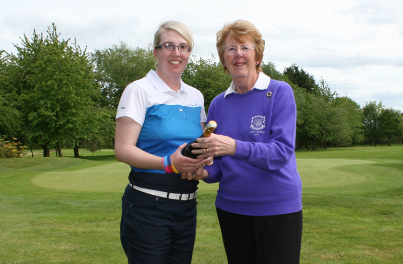 Shrewsbury Golf Club Lady Captain, Tina Robinson presents Katrina Gillum with Champagne