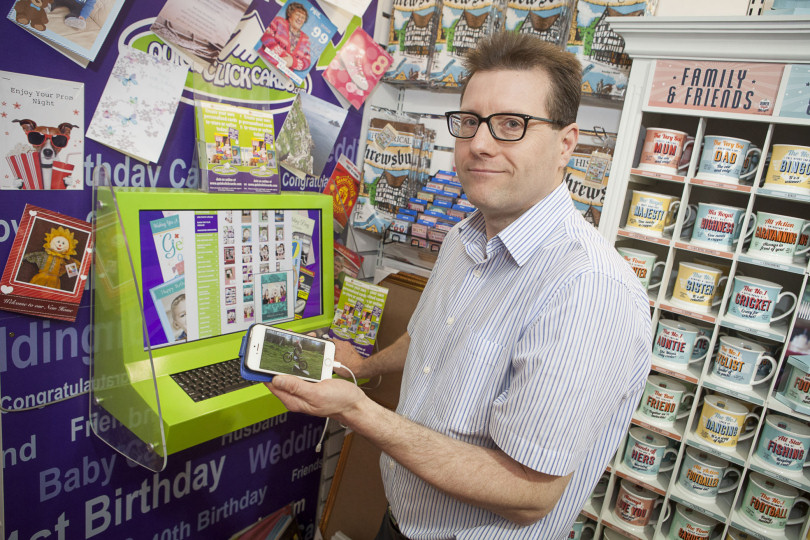 Shrewsbury greetings card shop in uk retail first shropshire live shop owner paul howl prepares to upload an image from an iphone to create a personalised m4hsunfo