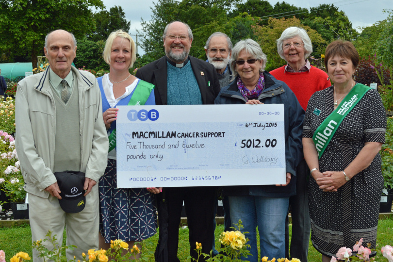 Pictured at the cheques presentation are Keith Egerton, Macmillan Cancer Support's fundraising manager for Shropshire Helen Knight, the Rev Stephen Harrop of St Michael and All Angels Church, Welshampton, Nick Eleftheriou, Country Garden Roses owner Mary Jinks, Gill Eleftheriou and Macmillan Cancer Support area manager Jenny Goddard