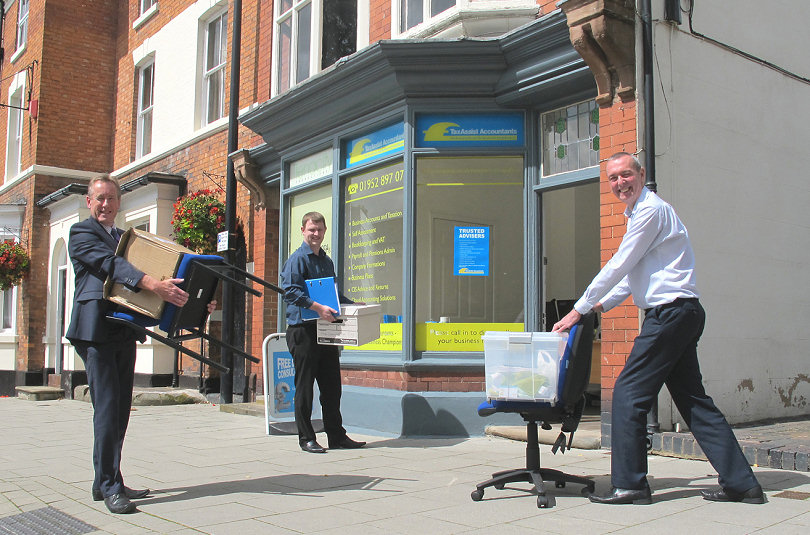 Nigel Lomax and Craig Powell of TaxAssist Accountants, getting a helping hand from Tony Arthur of Advantage Office Supplies to move into the new office
