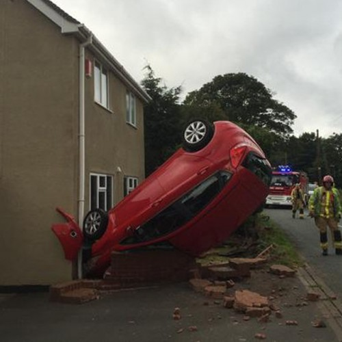 Car overturns and crashes into house in Wheat Leasows