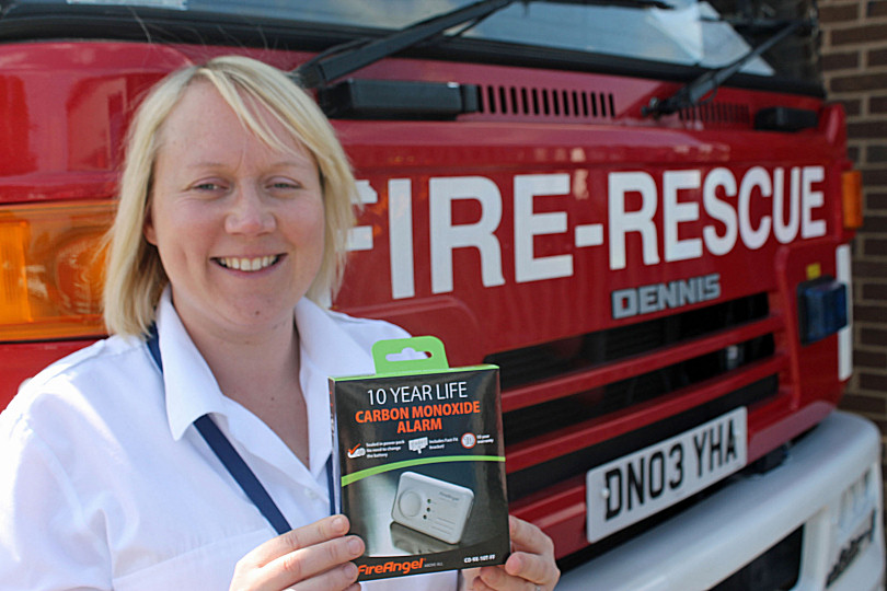 Laura Kavanagh-Jones with a carbon monoxide alarm