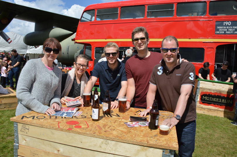 A group enjoy soaking up the atmosphere at last year's Cosford Food Festival