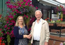 OBU3A Chairperson, Pam Broomby, receives the keys and a welcome from Gareth Jones, Chair of Oswestry Senior Citizens Club, which is to be the new meeting venue for OBU3A from October