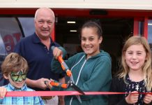 Tudor Griffiths joins competition winners (from left) Noah Faulkner, Issy Lear, and Olivia Hall to officially open the new branch