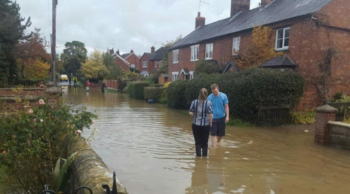 The scene of the flooded street in Prees. Photo: @NorthShropCops