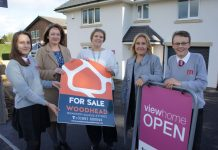 Eva Nikolova of The Marches School Eco Committee , Kate Howell owner of Woodhead Oswestry Sales and Lettings, Jo White Business Development Manager at The Marches School, Lorraine Hopkins Marketing & PR Manager at Tesni Homes, Niall Dennehy of The Marches School Eco Committee. All standing outside Tesni's new view home on Morda Road