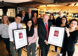 The renowned local wine merchants are seen celebrating after winning the awards