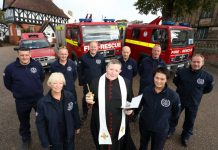 Canon Jonathan Mitchell, the Dean of Shrewsbury Cathedral, blesses the fire engines in a traditional ceremony in Shrewsbury before the trip to Romania. He is pictured with Ann Lewis (left) and Jean Jones. Back, L-R, Scott Hurfield, John Hammond, Steve Worrall, Shropshire and Wrekin Fire Authority member Councillor Mal Price, Mark Briscoe and Steve Purslow