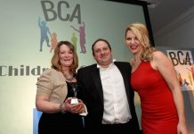 Sally and Stephen Johnson collect the award for the 2016 BCA Children's Charity from Steff Parker, representing Beaumont Lawrence