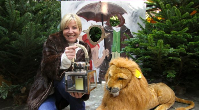 Anna Kayiatou with Aslan and one of the cut-out boards, depicting Mr Tumnus and Lucy Pevensie