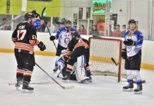 Rick Plant and Sam Zajac put pressure on the Peterborough netminder. Photo: Steve Brodie