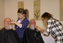 Tony Cook and Peter Love of Shrewsbury Severn Rotary Club have their beards shaved for charity