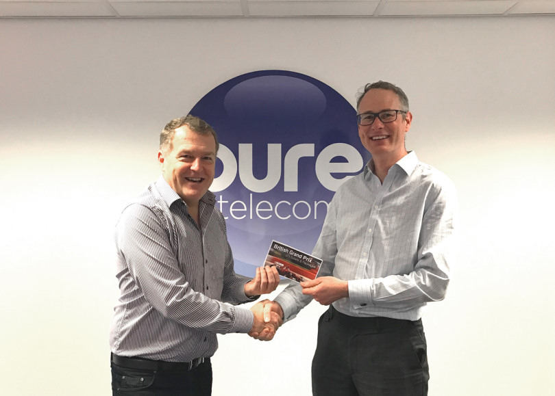 Matt Sandford of Pure Telecom presents James Baily of Nowcomm with his prize