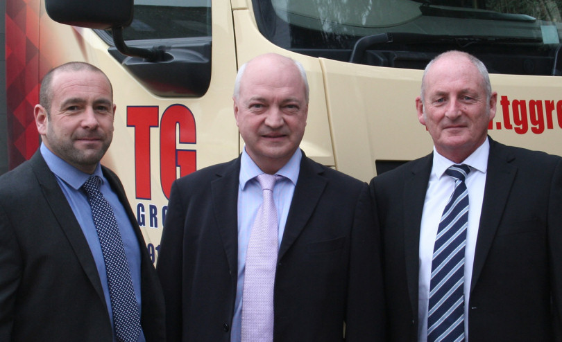 Kevin Gardner (right) who is retiring from Tudor Griffiths Builders' Merchants with Tudor Griffiths (centre) and Kevin's successor, Mark Evans