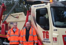 Divisional Manager Kevin Gardiner (left) and driver Rob Davis from TG Skip Hire in Tattenhall with the new truck