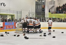 The Tigers players celebrate at the end of the game. Photo: Steve Brodie